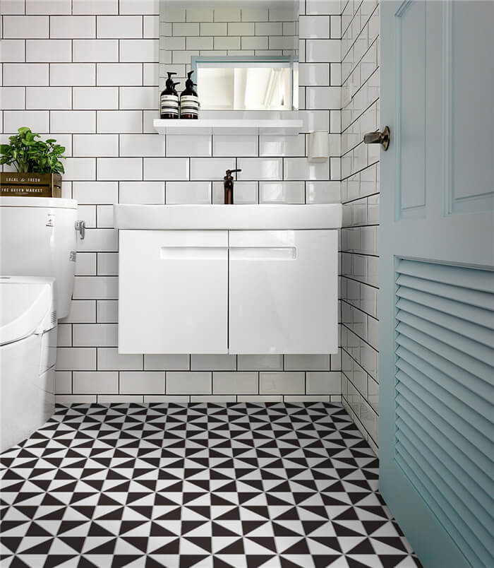 4 inch windmill tiled floor adds highlights to small bathroom