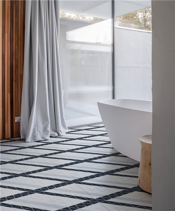 "A open shower with big bathtub, flooring with 2"" blue mountain ribbon geometric mosaic designs"